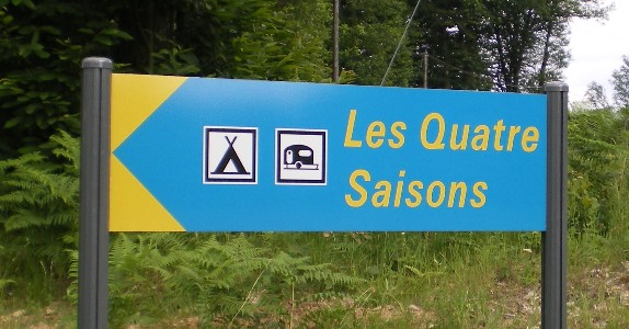 Les Quatre Saisons road sign